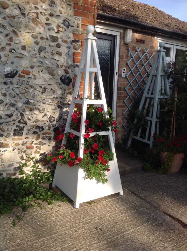 Wooden garden obelisk with integral planter, one of our