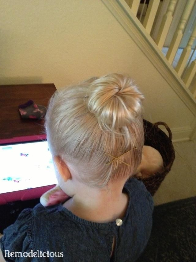 Creating a Perfect DIY Toddler Ballerina (Sock) Bun -- I think the ipad is key for achieving this style