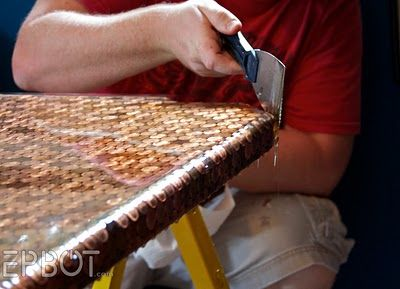A Work Desk Topped With Pennies And Sealed With Bar Top Epoxy. Someone Had