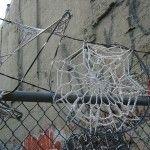 Invasive crochet: Lace doilies and razor wire