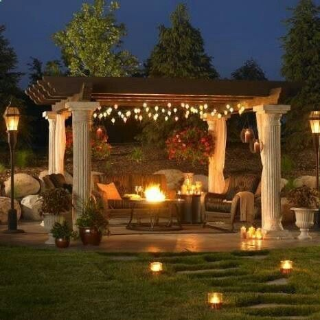Great Pergola! Love the fire pit! And the Grecian pillars combined with the rustic wood is fabulous!   Men Made Home