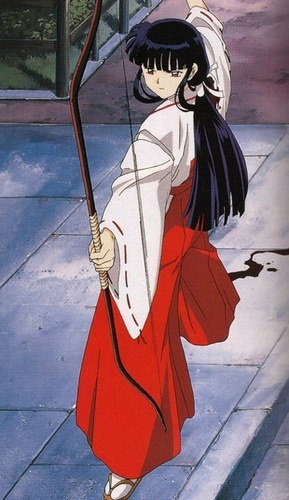 Kikyo, archer priestess, wounded and sealing InuYasha to a tree with a sacred arrow - screenshot from InuYasha, episode 1