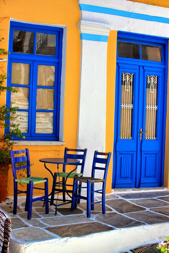 Greek cafe with colorful traditional facade. Lefkes, Paros island, Cyclades, Greece