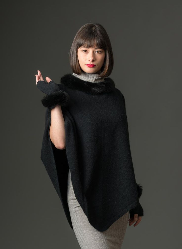 This black possum merino wool cape with real New Zealand possum fur trim is gorgeous and it looks even better teamed with the fur trimmed wrist-warmers that match. Or match this cape with the matching Black possum merino beret or long wrist warmers. A luxury blend of 20% possum fur mixed with 70% merino lambs wool and 10% silk in classic black. Knitwear made in New Zealand.