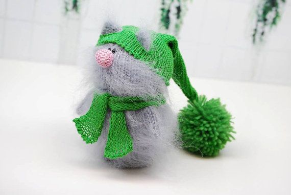 Lincoln is a very serious amigurumi kitten made of fuzzy grey mohair. He is a very serious guy! Lincoln loves politics and Christmas! He has nice green removable hat and scarf. Hat and scarf are made of fabulous natural linen yarn! The hat and scarf can be swapped with other characters.