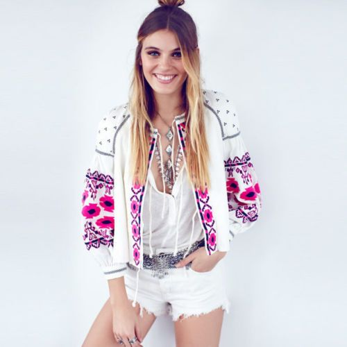 Absolutely stunning! A gorgeous white base pairs with intricate pink & blue embroidery on this expertly constructed jacket. Designed with a swingy shape, this jacket has long sleeves, side pockets, an