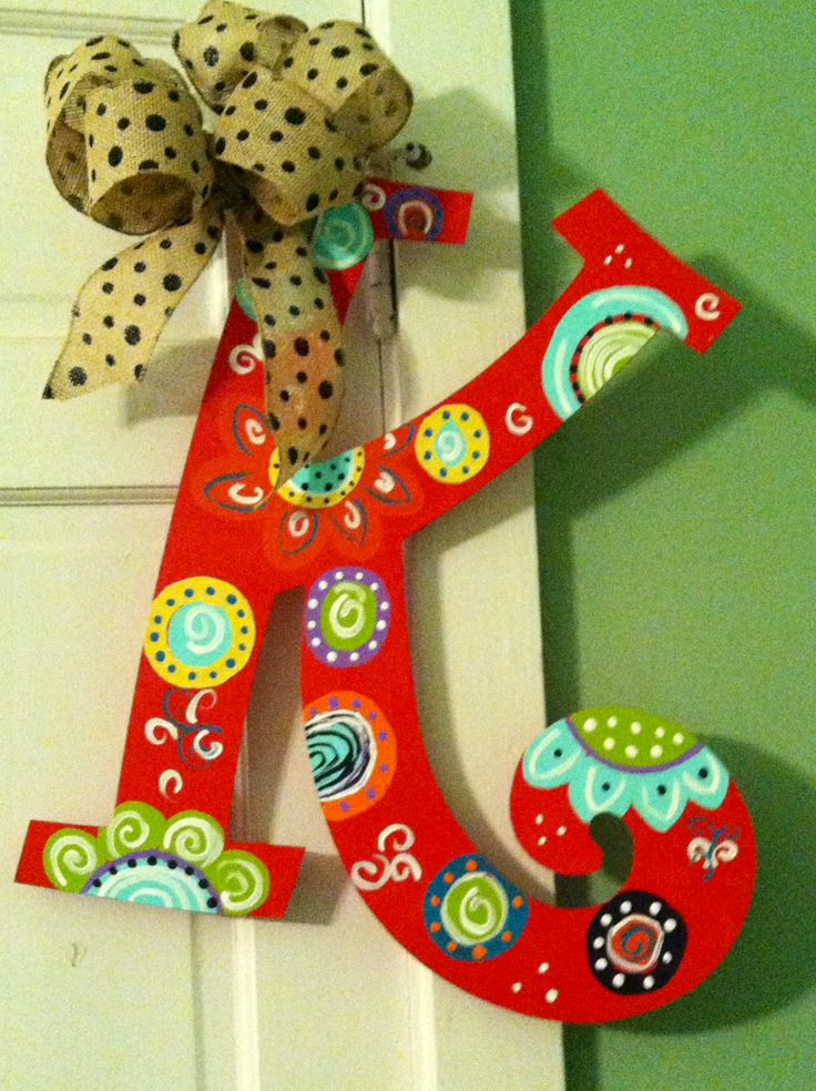 Hand painted wooden door hanger with a pop of personality