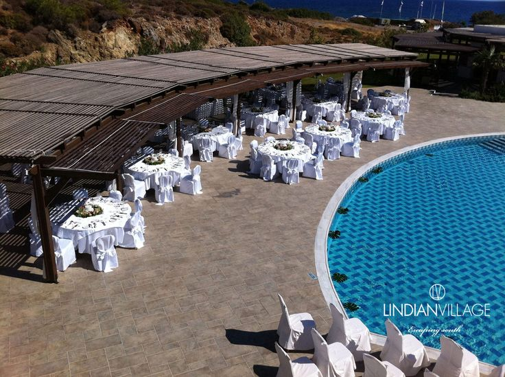 A wedding reception by the poolside, with the gentle breeze and the eternal Greek sunshine completing the wonder! more at lindianvillage.gr