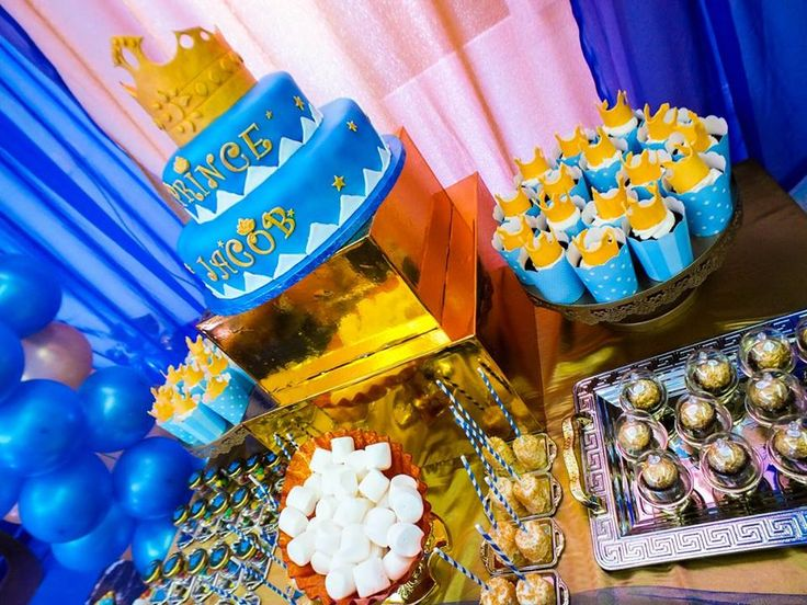 my royal cake and cupcakes on the dessert table
