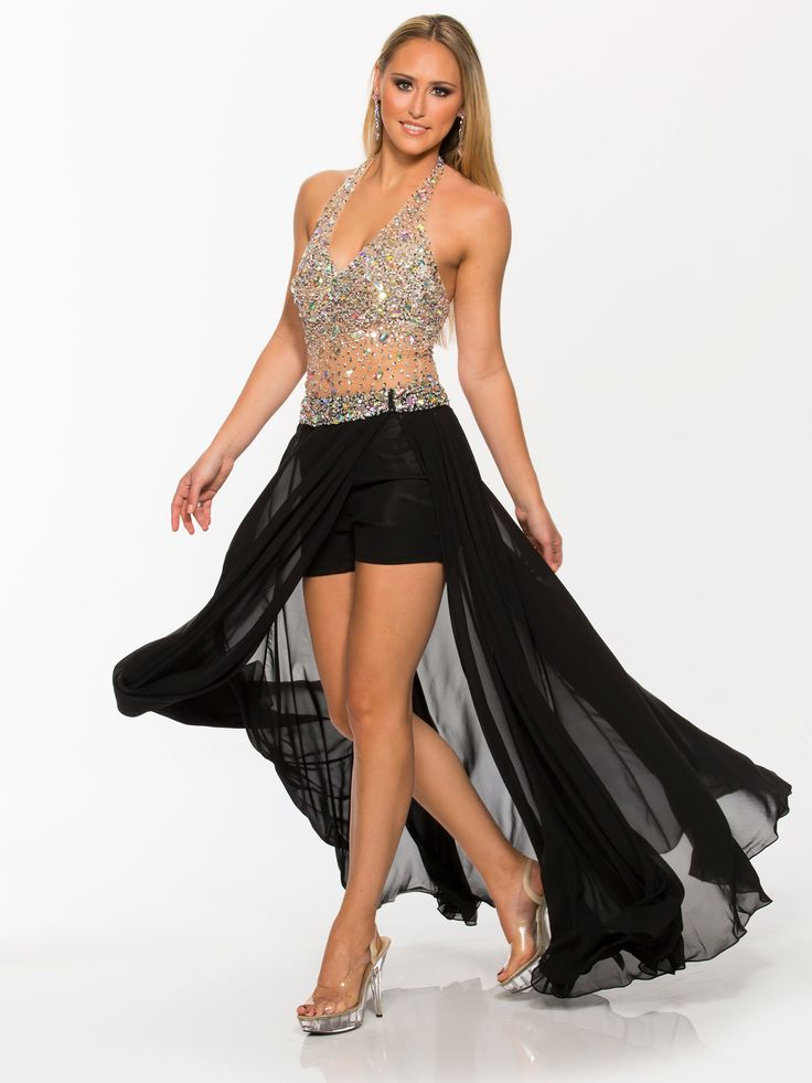 Embrace this breathtaking hi-low prom dress as the epitome of sex appeal and exquisite shimmering. A sheer illusion halter fitted bodice plunged by a deep v-neckline showcases a revealing nude waist that leads to hot pants made of silky Black fabric. A detachable tulle overskirt with matching embellished natural waist belt injects the really versatile hi-low effect. Also in jumpsuit with a price of 358 dollars. Available in Black Nude. Sling-back clear platform heels will let you show off…