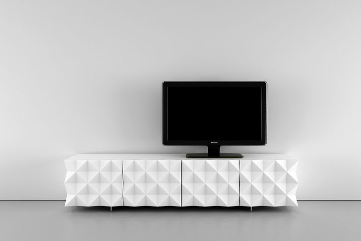 Rocky TV stand- Entertainment system from the Rocky Collection designed by Joel Escalona, configured with four compartments, detailed in its sides and front with pyramid pattern and cable outlet at the bottom rear. Made of particle board and chromed metal legs. Finished in semi-gloss lacquer interior and exterior with different tones.  #TVstand #Furniture #coolinteriors #Storage  #Design