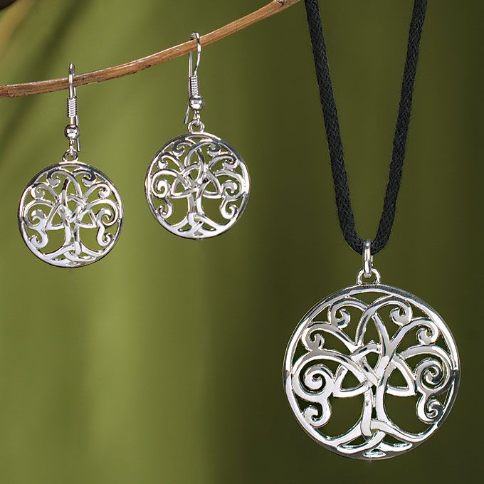 "An openwork Irish Tree of Life is centered with a Trinity Knot showcases a lovely interpretation of this unending love symbol.  ""Love should be a tree whose roots are deep in the earth, but whose branches extend into heaven.""  Bertrand Russell"