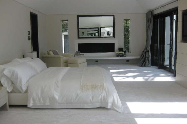 Modern and spacious bedroom with a clean, white, elegant aesthetic.
