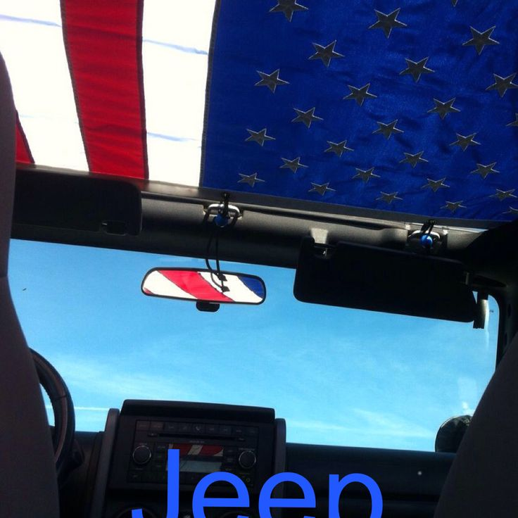 Took this photo from our Jeep last summer. The flag made a sweet bikini top. Scott placed grommets around the flag and used small bungees to secure it to the Jeep frame. I think the pic says it all.