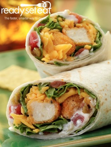 "Spicy Crunchy Chicken Wraps... ""Easy and quick 2 step recipe for a casual weeknight meal. These delicious wraps are a great spicy summer option your family will love!"""