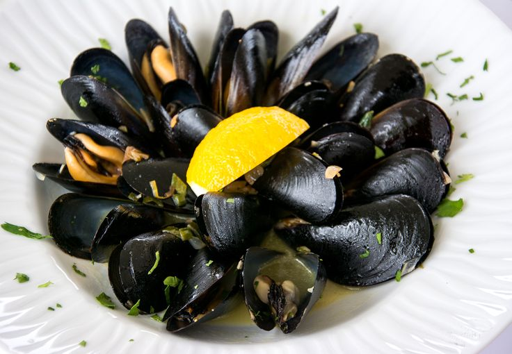 Steamed mussels with fresh herbs and lemon cooked in their broth by Aelia Beach Bar Restaurant.