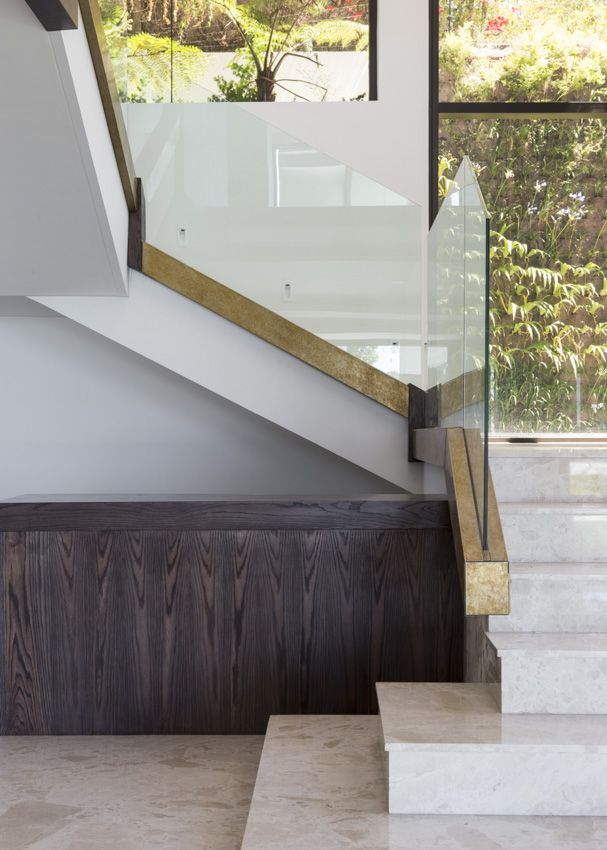 beautiful staircase with marble, timber & brass