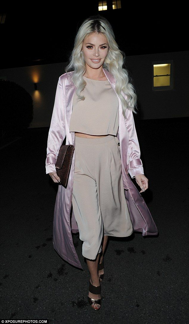 Pale and interesting: Chloe Sims took a fashion risk in beige co-ords and a pink duster ja...