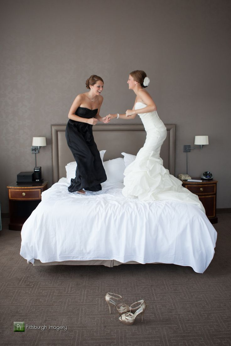 Bride and sister jumping on bed. We are definitely getting pictures of us jumping on the bed!