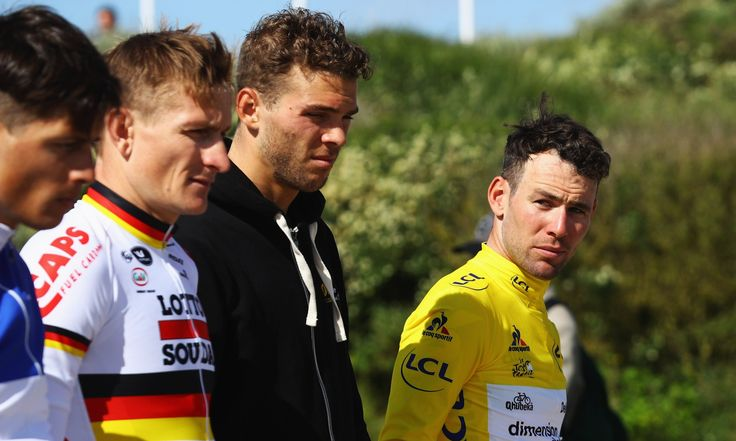Mark Cavendish of Great Britain (right) and fellow riders observe a minute's silence at a war memorial at Utah Beach, Sainte-Marie-du-Mont, after stage one of the Tour de France 2016. Photograph: Bryn Lennon/Getty Images