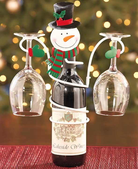 The Christmas Holiday Wine Bottle & Glass Holder is a fun way to celebrate the season. A finely detailed, cheerful face sits atop a spiral body that fits ar
