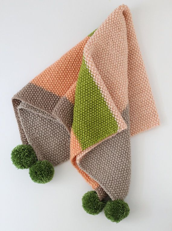 knitted baby blanket with pompoms