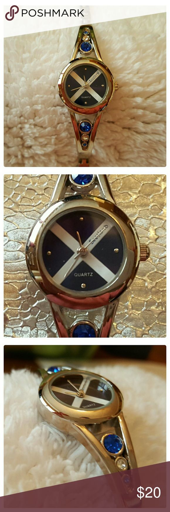 """JUST IN: SS Ladies Watch (Never Worn) Stainless Steel ladies watch with the Scottish St Andrews Flag on face. Bought in Scotland, gifted to me but never worn.  I just don't wear watches anymore. Will fit upto 8 """" wrist. Has pretty blue and clear crystals on either side of watch face. Will need a new battery. Excellent condition. Stainless steel does not tarnish, is durable and scratch resistant. Ravel Accessories Watches"""