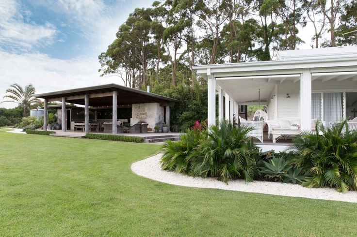 Outdoor Pavillon, with outdoor kitchen and large stone fireplace is where all the fun happens at The Grove Byron Bay. Contrasted from the white exterior of the house, is this masculine mix of concrete, timber and stone , super maintainable and handles all sub tropical weather has to throw at it