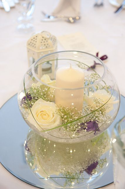 fish bowl 4 white flower , then one of each color 4 bridesmaids with candle: