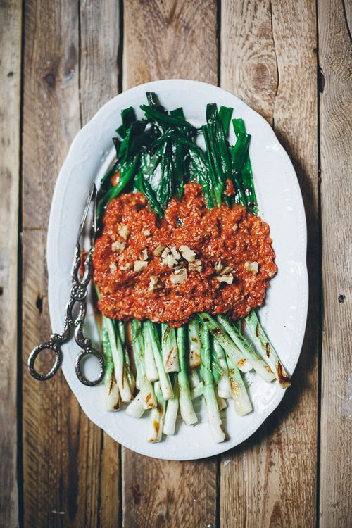 grilled green onions with walnut romesco...