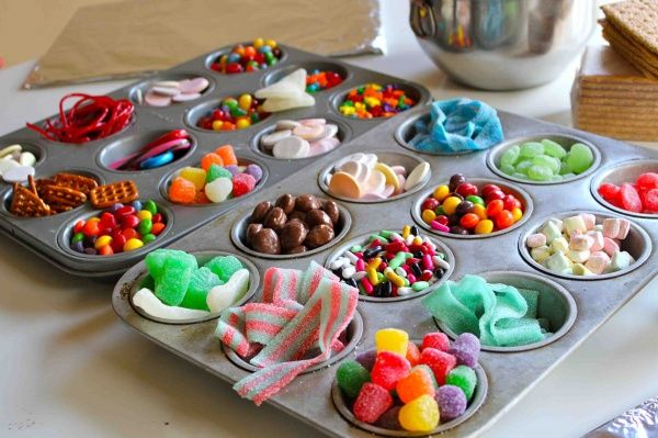 Organization idea for gingerbread party...use mini muffin tins from Dollar Tree, one for each girl to pick what she wants from the candy buffet