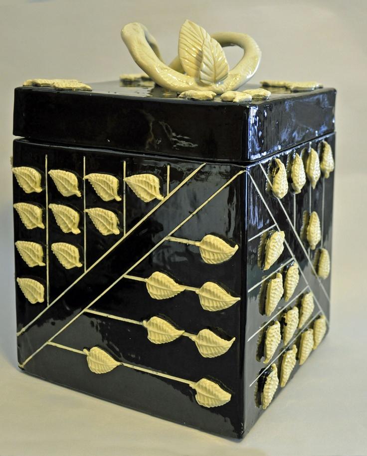 """12"""" clay box, slab built, press mold leaf additions, sgraffto P."""