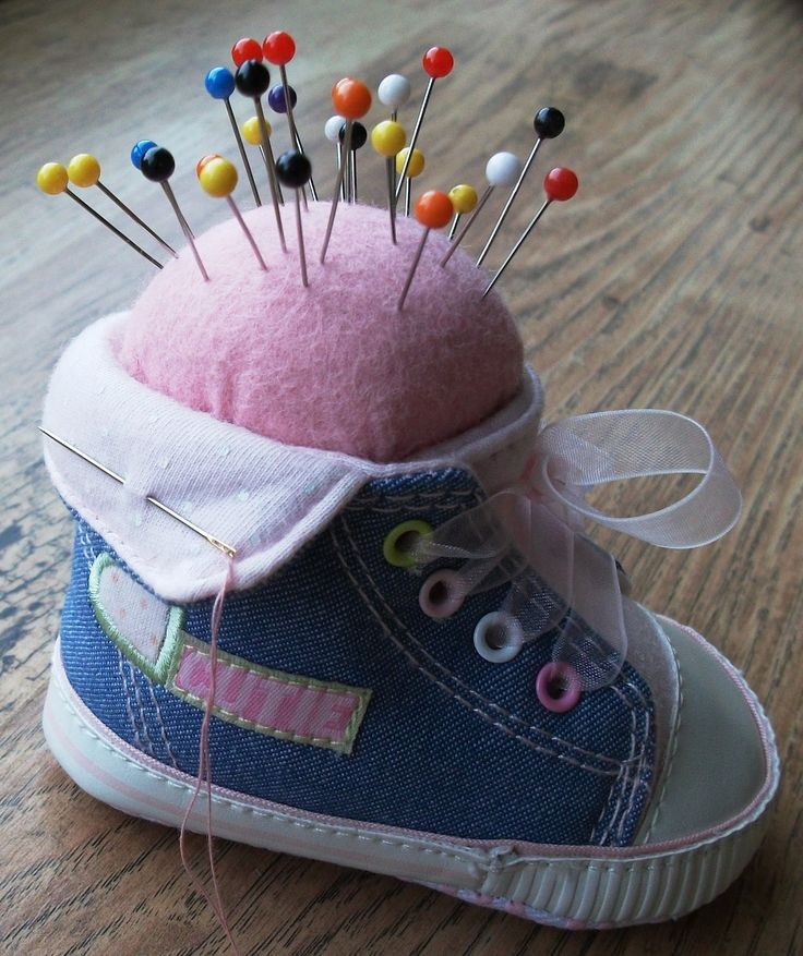 I think this might just qualify for the title of cutest pincushion ever...      A huge bag of baby shoes was lying in a corner of my sewin...