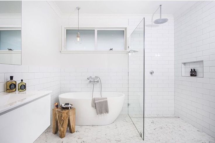 note basic use of white low cost tiles fully tiled only in shower low cost shower - walk in = one glass only budget floor standing bath budget wall hung vanity single budget (bunnings/kmart) pendant over bath looks designer but cheap