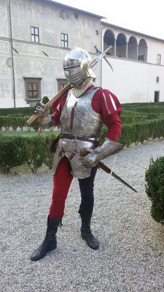 Italian Renaissance military dress- heavy metal armor usually worn with hose for easy movement. Again paired with a metallic helmet for protection.