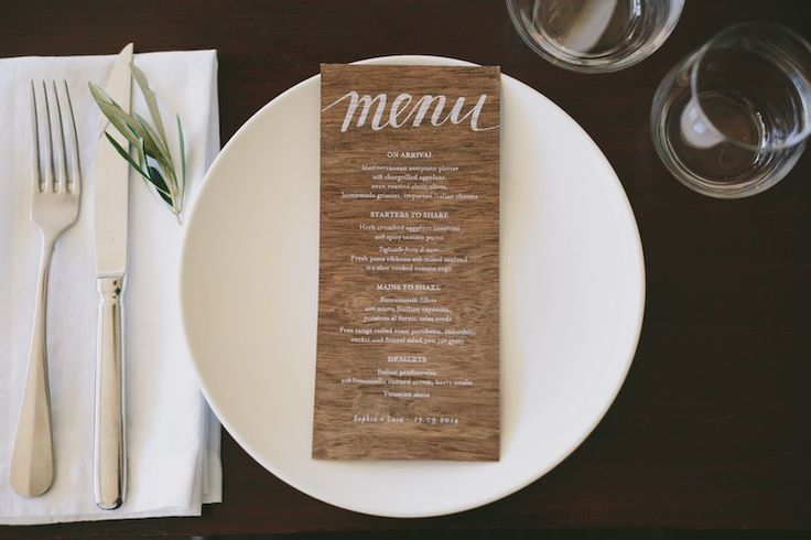 Wooden menu with hand lettering by Cartamodello Papeterie (http://www.cartamodello.com.au) | Photography by Cookoo Design and Photography (http://www.cookoodesignandphotography.com) | Styling by Bespoke Occasions (http://www.bespokeoccasions.com.au) | Flowers by Pollen Florist (http://www.pollenflorist.com.au) | Shot on location at Ave Cucina, Coorparoo | Featured on The Ever After Story (http://www.theeverafterstory.com) #whiteink #wooden #wedding #stationery #woodmenu #whiteprinting