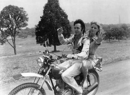 Paul and Linda McCartney on a motorcycle