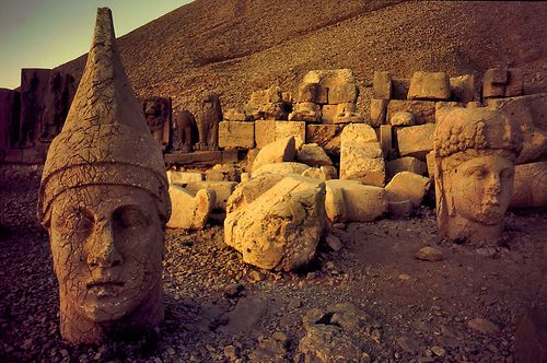 Nemrut Dagi, Turkey.  Statues at the peak of mountain, only a long drive through the Kurdish country side and a hike will you arrive at this magical place.