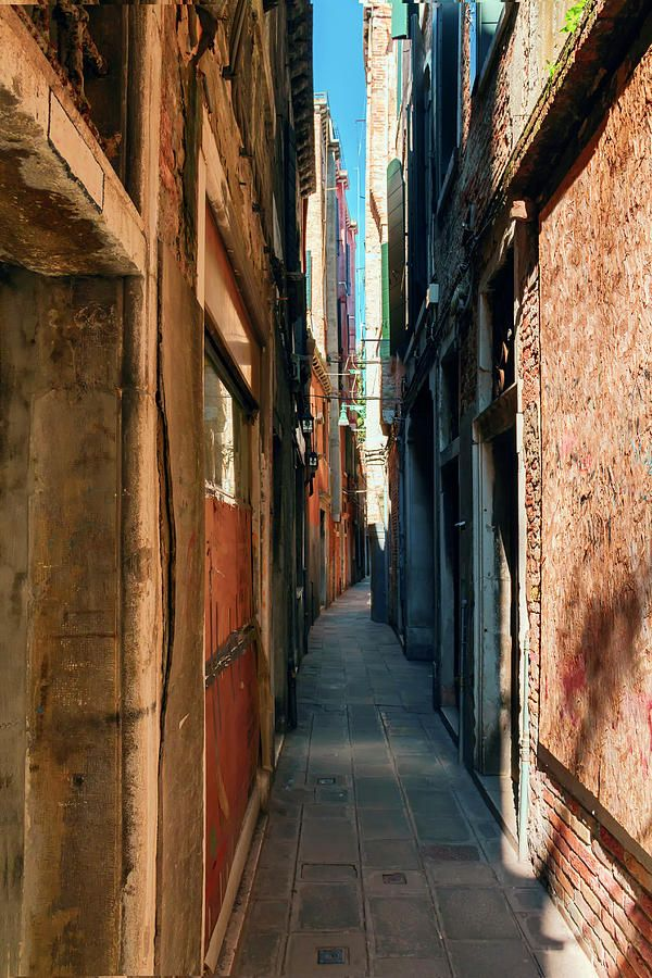 George Westermak Photograph - one of the many narrow streets of Venice on a…