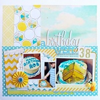 beautiful scrapbook page from jill sprott.  gorgeous colours and layers, and particularly in love with how she altered the circle paper in that wide strip at the top.