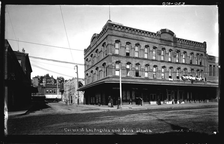 Corner of Los Angeles and Arcadia Streets, William H. Fletcher, 1895 | Looking west on Arcadia Street from Los Angeles Street, Fort Moore Hill in the background. The three story Jenrette building is on the northwest corner of Arcadia and Los Angeles Streets with Sanchez Alley running directly behind it up to the Plaza at Republic Street. I believe Hancock Banning's residence is visible on the summit of Fort Moore Hill. Photo is misidentified. Aliso Street did not exten