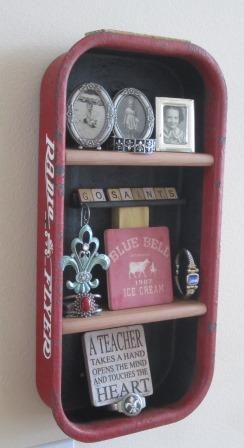 "Small Red Flyer Wagon used as a shadow box wall shelf. Go to www.coolchairs.net or www.coolcottage.net More pictures coming soon. This is the small size wagon (weighs about 2-3 pounds). I recommend this over the larger (34"" L) wagon which weighs 10# before any items are placed inside. GO SAINTS"