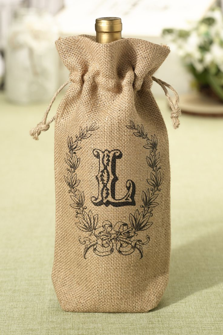 We love the monogram on these burlap wine bags.  Add a bottle of wine and it is the perfect gift for just about anyone.