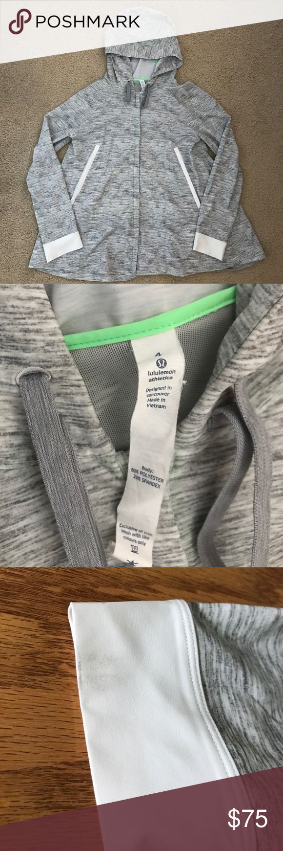 Lululemon Sun Showers Lightweight Rain Jacket Perfect condition lightweight jacket with a cute A-line shape. I love this piece but never wear it.  Very slight staining at cuffs, see picture lululemon athletica Jackets & Coats