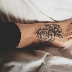 Floral rose foot tattoo, love the shading and style of flowers here.