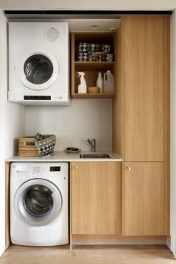 Compact wash basin and cabinet design. The dryer area can be replaced with more storage space