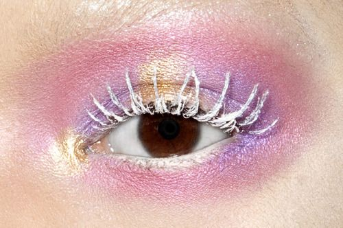 White chrome lashes against a contrasting eyeshadow