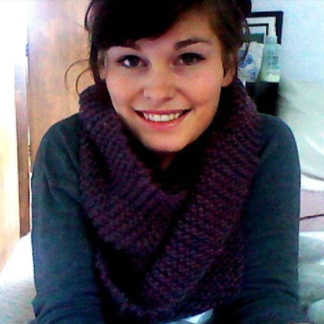 Purple hand-knitted loop scarf.