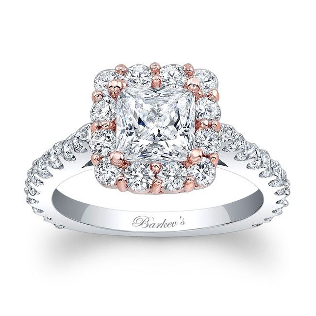 Stunning and in vogue, this two tone rose and white gold diamond halo engagement ring will capture the eye of many admirers. Featuring a rose gold halo top, set with shared prong set diamonds encircling the princess cut diamond center. The white gold shank is adorned with diamonds cascading down the narrow shank.  <br /> <br /> Also available in  two tone yellow, 18k and Platinum.