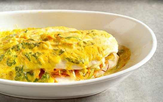 Scholfilet met kerrieroom uit de oven, een sandwich van scholfilet gevuld met wortel in een kerriesausje uit de oven. Een heerlijk en makkelijk gerecht!